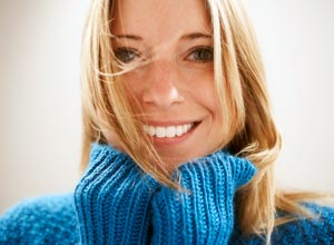 Smiling girl in blue sweater